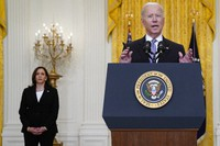 Vice President Kamala Harris listens as President Joe Biden speaks about distribution of COVID-19 vaccines, in the East Room of the White House, on May 17, 2021, in Washington. (AP Photo/Evan Vucci)