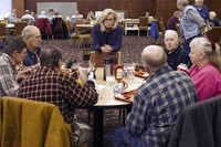 In this Feb. 1, 2016, file photo, Liz Cheney, center, talks to people at the Senior Citizens Center in Gillette, Wyo., after earlier in the day announcing she would run fro Congress. (Ed Glazar/Gillette News Record via AP)