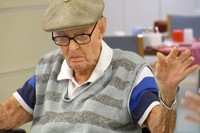 In this image made from video, Australia's Dexter Kruger gestures at a nursing home in the rural Queensland state town of Roma, Australia on May 13, 2021. (Australian Broadcasting Corporation via AP)