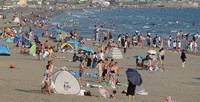 Yuigahama Beach (foreground) and Zaimokuza Beach (background) are seen in Kamakura, Kanagawa Prefecture, on Aug. 14, 2020. Although the beaches were not officially open to swimmers, some people visited anyway. (Mainichi/Hiroshi Maruyama)