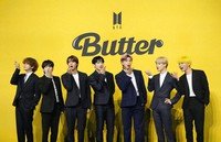 """Members of South Korean K-pop band BTS pose for photographers ahead of a press conference to introduce their new single """"Butter"""" in Seoul, South Korea, on May 21, 2021. (AP Photo/Lee Jin-man)"""
