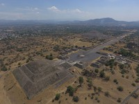 In this March 19, 2020 file photo, the Pyramid of the Moon, left, and the Pyramid of the Sun, back right, are seen along with smaller structures lining the Avenue of the Dead, in Teotihuacan, Mexico. (AP Photo/Rebecca Blackwell)