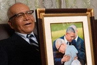 Hibakusha Shigeaki Mori is seen reflecting on his 2016 hug with then U.S. President Barack Obama, with the picture of the moment by his side, in Hiroshima's Nishi Ward on May 21, 2021. (Mainichi/Naohiro Yamada)