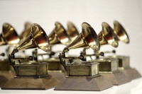 In this Oct. 10, 2017, file photo, various Grammy Awards are displayed at the Grammy Museum Experience at Prudential Center in Newark, N.J.  (AP Photo/Julio Cortez)
