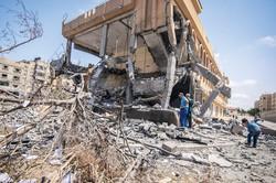 破壊されたガザ地区の建物 (Bloomberg)