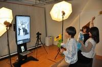 Customers are seen posing for selfies at Nove Studio, in Nishi Ward, Osaka, on May 26, 2021. (Mainichi/Yoshi Sekiya)