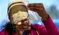 A health worker prepares a dose of the Pfizer coronavirus vaccine at the newly opened mass vaccination program for the elderly at a drive-thru vaccination center outside Johannesburg in South Africa, on May 25, 2021. (AP Photo/Themba Hadebe)