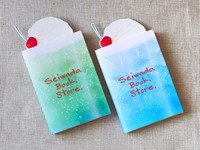 Summery book covers with a soda float design are seen with the bookmarks representing the ice cream part, in this image provided by Seiwado Book Store.