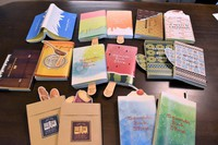 The unique book cover designs by Yasuhiro Konishi for his family's Seiwado Book Store are seen in this image taken in Tsurumi Ward, Osaka, on May 15, 2021. Some of the designs include special bookmarks, such as the spoon for the honey-themed cover. (Mainichi/Mai Suganuma)