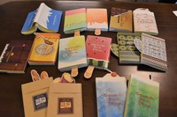 The unique book cover designs by Yasuhiro Konishi for his family's Seiwado Book Store are seen in this image taken in Tsurumi Ward, Osaka, on May 15, 2021. Some of the designs include special bookmarks, such as the spoon for the honey-themed cover. (Mainichi/Mai Suganuma) =Click/tap photo for more images.