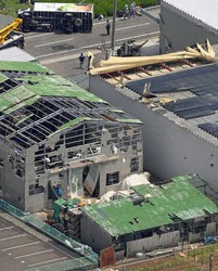 A factory and other buildings are seen damaged by what is believed to have been a tornado in the Shizuoka Prefecture city of Makinohara, on May 2, 2021. (Mainichi/Hiroshi Maruyama)