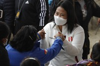 Presidential candidate Keiko Fujimori greets a woman upon her arrival to a breakfast with supporters in Lima, Peru, on June 6, 2021. (AP Photo/Guadalupe Pardo)