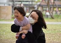 Yukiko Yamagami hugs her eldest daughter Nana, who has Down syndrome, in Saitama Prefecture on March 28, 2021. (Mainichi/Ayumu Iwasaki)