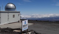This 2019 photo provided by NOAA shows the Mauna Loa Atmospheric Baseline Observatory, high atop Hawaii's largest mountain, to sample well-mixed background air free of local pollution. (Susan Cobb/NOAA Global Monitoring Laboratory via AP)