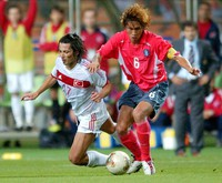 In this June 29, 2002 file photo, South Korea's Yoo Sang-chul, right, competes for the ball with Turkey's Ilhan Mansiz during the 2002 World Cup third place playoff soccer match between South Korea and Turkey, at the Daegu World Cup stadium, in Daegu, South Korea. (AP Photo/Tony Gutierrez)