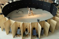 """Audience members watch the Moon Light Theater dance company's latest work """"Peeping Garden / re:creation,"""" which takes place on a circular stage, as the spring special performance of the """"Odoru-Akita"""" dance festival in the city of Akita on May 30, 2021. (Mainichi/Kota Yoshida)"""