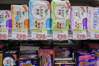 Various types of feminine hygiene products are lined up in a store in Tokyo on Feb. 5, 2021. (Mainichi/Miyuki Fujisawa)