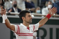 Serbia's Novak Djokovic reacts as he defeats Spain's Rafael Nadal during their semifinal match of the French Open tennis tournament at the Roland Garros stadium on June 11, 2021, in Paris. (AP Photo/Michel Euler)