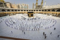 In this July 31, 2020, file photo, pilgrims walk around the Kabba at the Grand Mosque in the Muslim holy city of Mecca, Saudi Arabia. (Saudi Ministry of Media via AP, File)