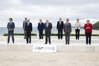 Leaders of the G7 pose for a group photo on overlooking the beach at the Carbis Bay Hotel in Carbis Bay, St. Ives, Cornwall, England, Friday, June 11, 2021. (AP Photo/Patrick Semansky, Pool)