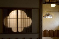 Windows decorated with motifs of plum, left, and pine are seen in the Tagoto room of the former Japanese-style restaurant Kaneyu in Noshiro, Akita Prefecture. (Mainichi/Akihiro Ogomori)