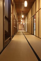 The 25-meter-long corridor is seen on the first floor of the former Japanese-style restaurant Kaneyu in Noshiro, Akita Prefecture, on May 26, 2021. Custom-made, seamless mats cover the hallway. (Mainichi/Akihiro Ogomori)