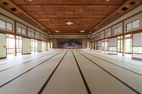 The large hall with 110 tatami mats on the floor is seen at the former Japanese-style restaurant Kaneyu in Noshiro, Akita Prefecture, on May 26, 2021. Geisha used to dance on the stage pictured in the background. (Mainichi/Akihiro Ogomori)