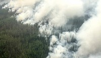 This image taken from video provided by the Russian Emergency Ministry on June 13, 2021 shows a view of a forest fire in the Irkutsk region. (Russian Emergency Ministry Press Service via AP)