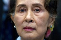 In this Dec. 11, 2019, file photo, Myanmar's leader Aung San Suu Kyi waits to address judges of the International Court of Justice in The Hague, Netherlands.  (AP Photo/Peter Dejong)