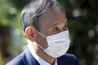 Japan's Prime Minister Yoshihide Suga arrives for a working session at the G7 summit in Cornwall, England, on June 12, 2021. (Brendan Smialowski/Pool via AP)