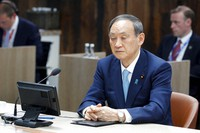 Japanese Prime Minister Yoshihide Suga attends a plenary session, during the G7 summit in Carbis Bay, England, on June 13, 2021. (Phil Noble/Pool via AP)