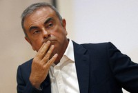 In this Sept. 29, 2020, file photo, former Nissan Motor Co. Chairman Carlos Ghosn holds a press conference at the Maronite Christian Holy Spirit University of Kaslik, north of Beirut, Lebanon. (AP Photo/Hussein Malla)