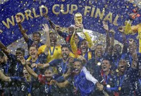 In this July 15, 2018, file photo, France goalkeeper Hugo Lloris holds the trophy aloft after the final match between France and Croatia at the 2018 soccer World Cup in the Luzhniki Stadium in Moscow, Russia. (AP Photo/Matthias Schrader)