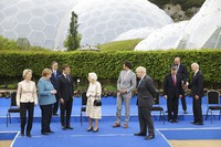 Britain's Queen Elizabeth II talks with G-7 leaders, from left, back row, President of the European Commission Ursula von der Leyen, German Chancellor Angela Merkel, Japan's Prime Minister Yoshihide Suga, French President Emmanuel Macron, Queen Elizabeth II, Canada's Prime Minister Justin Trudeau, Britain's Prime Minister Boris Johnson, Italy's Prime Minister Mario Draghi, President of the European Council Charles Michel and U.S. President Joe Biden before a reception at the Eden Project in Cornwall, U.K., on June 11, 2021, during the G-7 summit. (Jack Hill/Pool via AP)