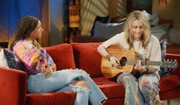 This photo released by Red Table Talk shows host Willow Smith, left, and Paris Jackson, who will appear in an episode of the talk show series to discuss living under the media glare. (Red Table Talk via AP)