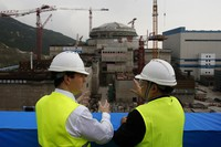 In this Oct. 17, 2013 file photo, then British Chancellor of the Exchequer George Osborne, left, chats with Taishan Nuclear Power Joint Venture Co. Ltd. General Manager Guo Liming as he inspects a nuclear reactor under construction at the nuclear power plant in Taishan, southeastern China's Guangdong province. (AP Photo/Bobby Yip, Pool)
