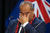 Pacific Peoples Minister Aupito William Sio reacts while talking about his personal experiences of the 1970's dawn raids during a post-Cabinet press conference at Parliament in Wellington, New Zealand, on June 14, 2021. (Mark Mitchell/NZ Herald via AP)