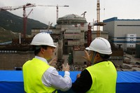 In this Oct. 17, 2013, file photo, then British Chancellor of the Exchequer George Osborne, left, chats with Taishan Nuclear Power Joint Venture Co. Ltd. General Manager Guo Liming as he inspects a nuclear reactor under construction at the nuclear power plant in Taishan, southeastern China's Guangdong province. (AP Photo/Bobby Yip, Pool)