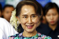 In this Dec. 14, 2018, file photo, Myanmar's deposed Leader Aung San Suu Kyi arrives to attend the Myanmar Entrepreneurship Summit at the Myanmar International Convention Center in Naypyidaw, Myanmar. (AP Photo/Aung Shine Oo)