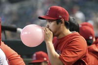 Los Angeles Angels' Shohei Ohtani blows up a balloon in the ninth inning during a baseball game against the Arizona Diamondbacks on June 13, 2021, in Phoenix. (AP Photo/Rick Scuteri)