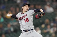 Minnesota Twins starting pitcher Kenta Maeda throws against the Seattle Mariners during the third inning of a baseball game, on June 14, 2021, in Seattle. (AP Photo/Ted S. Warren)
