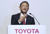 In this Aug. 4, 2017 file photo, Toyota Motor Corp. President Akio Toyoda answers a question during a joint press conference with Mazda Motor Corp. President Masamichi Kogai in Tokyo. (AP Photo/Eugene Hoshiko)