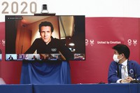 Olympic Games Executive Director of IOC Christophe Dubi speaks as chief of the main operation center of Tokyo 2020 Hidemasa Nakamura, right, looks on during a press briefing for the presentation of the version three of Tokyo 2020 Playbook in Tokyo, on June 15, 2021. (Behrouz Mehri/Pool Photo via AP)