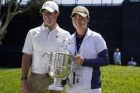 2021 U.S. Women's Open golf champion Yuka Saso poses with her champions trophy with Rory McIlroy during a practice round for the U.S. Open Golf Championship on June 15, 2021, at Torrey Pines Golf Course in San Diego. (AP Photo/Gregory Bull)