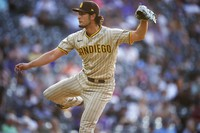 San Diego Padres starting pitcher Yu Darvish watches a throw to a Colorado Rockies batter during the first inning of a baseball game on June 15, 2021, in Denver. (AP Photo/David Zalubowski)