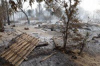 Smoke rises from smoldering houses in Kinma village, Pauk township, Magwe division, central Myanmar, on June 16, 2021. (AP Photo)
