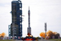 A Long March-2F Y12 rocket carrying a crew of Chinese astronauts in a Shenzhou-12 spaceship lifts off at the Jiuquan Satellite Launch Center in Jiuquan in northwestern China, on June 17, 2021. (AP Photo/Ng Han Guan)