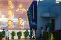Chinese astronauts prepare to depart on the Shenzhou-12 mission at the Jiuquan Satellite Launch Center in Jiuquan in northwestern China, on June 17, 2021. (AP Photo/Ng Han Guan)