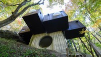 The exterior of Capsule House-K is seen in this photo taken by Shinjiro Yamada and provided by the Capsule Architecture Project.
