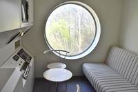 A bedroom at Capsule House-K, with an interior that evokes a neo-futuristic design, is seen in the town of Miyota, Nagano Prefecture, on May 10, 2021. (Mainichi/Mari Sakane)